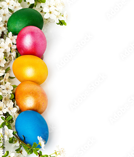 Easter background with eggs and spring flowers, text space