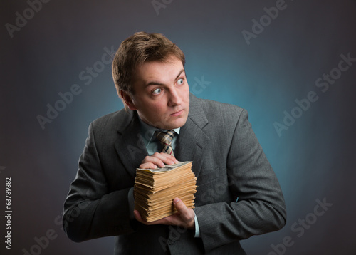 Man with pack of money  isolated on gray