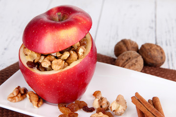 Stuffed apple with nuts and cinnamon
