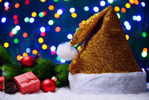 Santa hat on snow on lights background