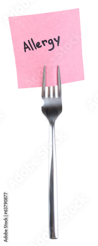 Note paper with message  attached to fork, isolated on white