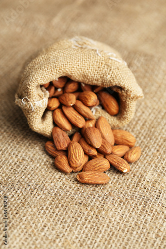 Almonds in sack on on sackcloth background