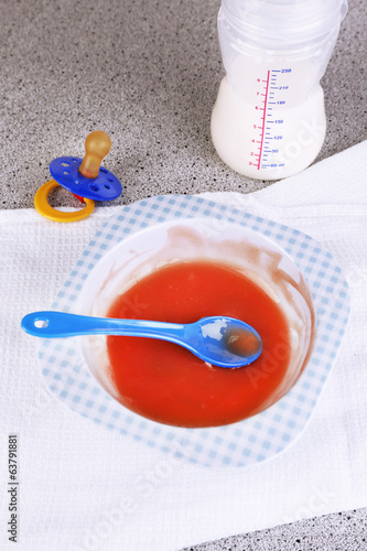 Baby food and milk on table close up