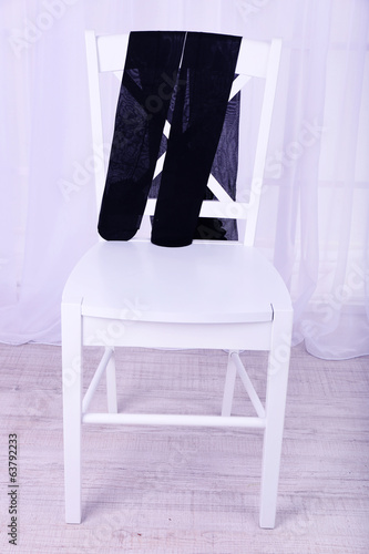 Pantyhose on wooden chair in room