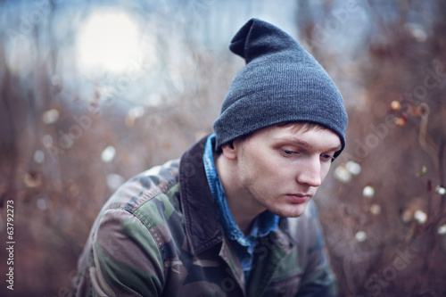 portrait of a sad young man outdoors .
