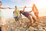 Fototapety Friends Dancing Limbo at Beach