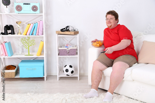 Lazy overweight male sitting