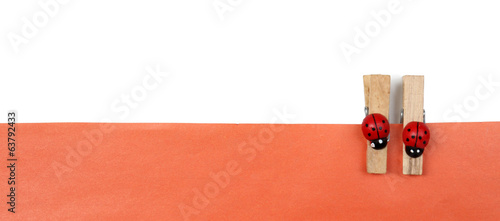 Abstract background with colorful wooden pins and paper