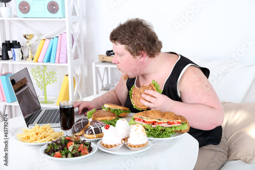 Fat man has a big lunch and playing games
