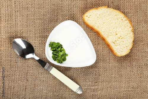 Bowl of creamy soup on burlap background