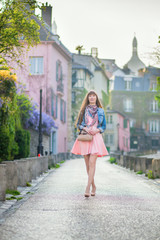 Beautiful girl in pink dress on Montmartre