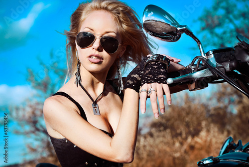 Stylized portrait of young beautiful woman on bike