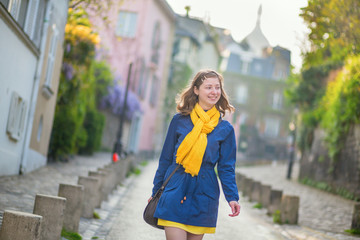 Happy young girl on a street of Montmartre