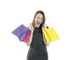 Excited shopping woman shouting with shopping bags