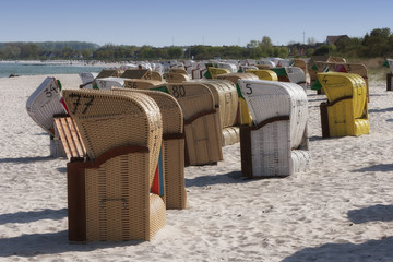 Hooded beach chairs at summer beach