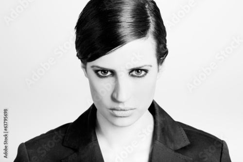 Woman with intense look on white background