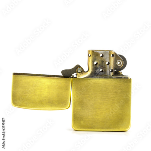 Golden lighter open on a white background isolated