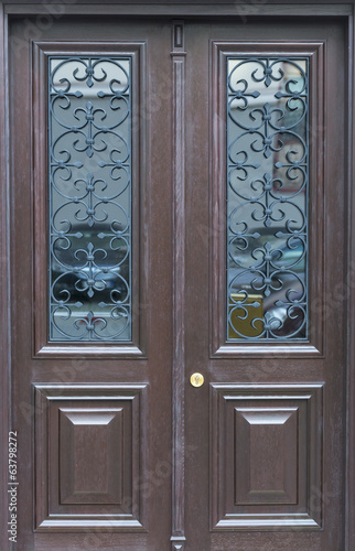 Wooden door with glass frames