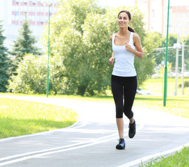 Running woman. Fitness model outdoors. Weight Loss