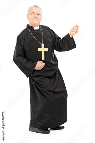 Happy priest playing air guitar