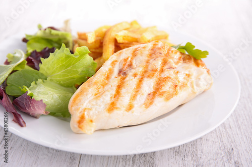 chicken breast with fries and salad