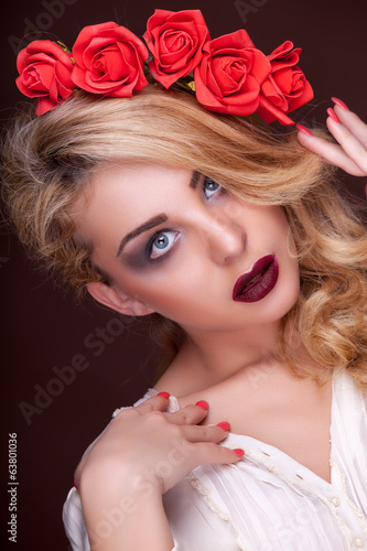 Sensual fashion woman with flowers in head