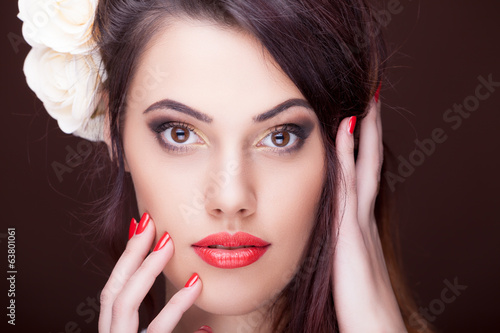 Beautiful woman professional make up on brown background