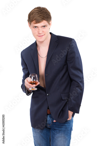 Young man posing with a glass of whiskey