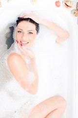 pretty woman enjoying hot foam bath