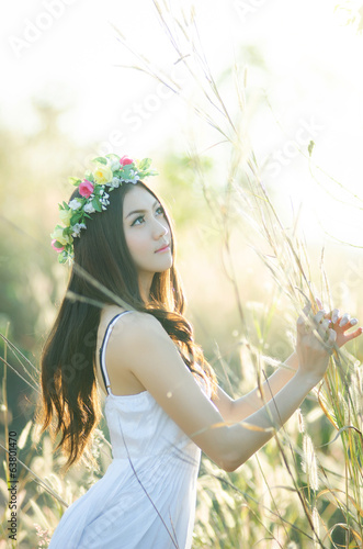 Pretty girl in a spring  flower garden 4