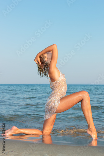 Woman on the beach in the evening