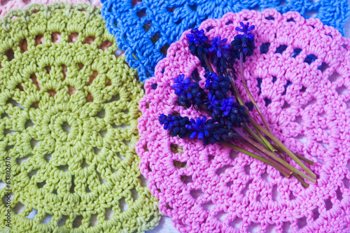 blue spring flowers on a crochet napkins