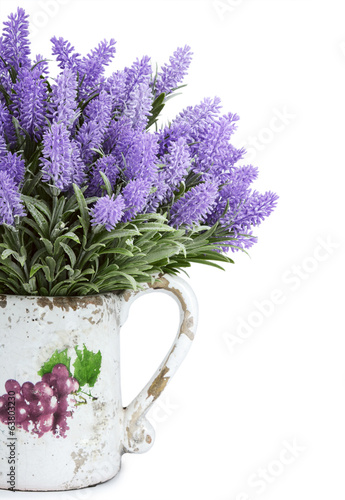 Jug with wild flowers isolated