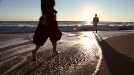 Couple kiss at sunrise on the beach