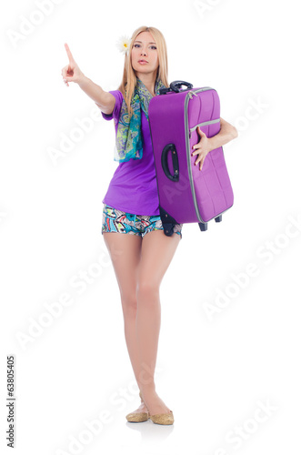 Woman preparing for vacation with suitcase  pressing virtual but