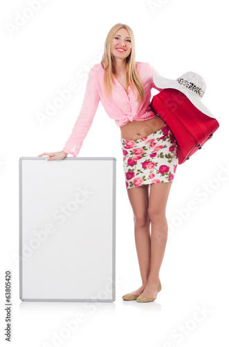 Attractive woman  preparing for vacation with suitcase and blank
