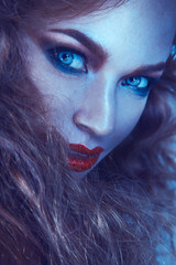 Cold tones portrait of cutie woman with freckles