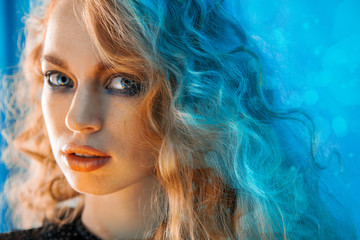 Horizontal portrait of beauty female with curly hair