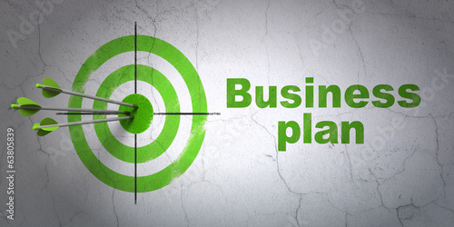 Finance concept: target and Business Plan on wall background