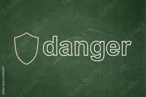 Security concept: Shield and Danger on chalkboard background