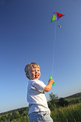 happy kid flies a kite