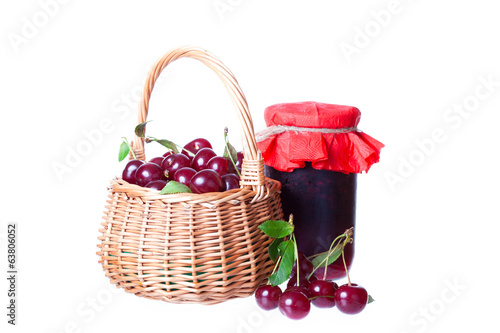Ripe cherry in a wattled basket and bank of cherry jam