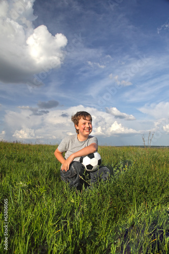 happy boy with ball outdoors