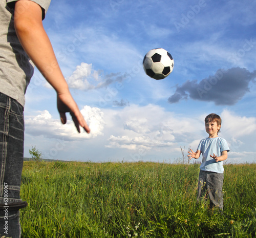 two boy play in football