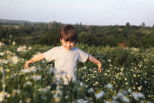 happy boy on green field