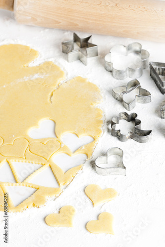 still life of dough with cookie cutters