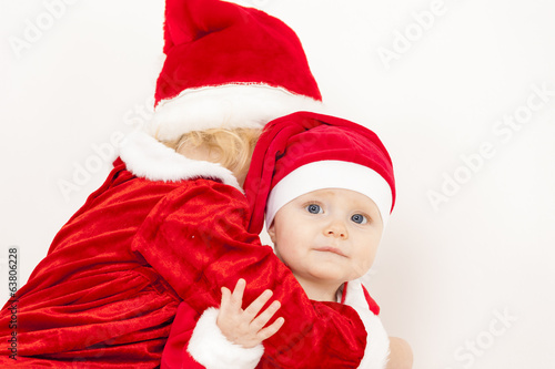 two little girls as Santa Clauses