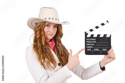 Young   pointing  cowgirl  with movie board isolated on white