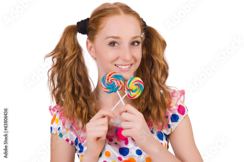 Redhead young girl with lolipops isolated on white