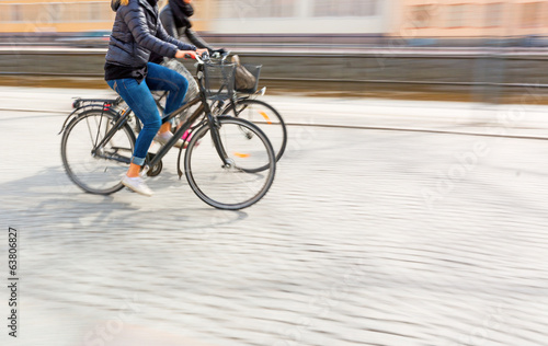 Two young women on bikes